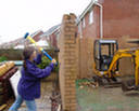 Helen taking a sledge hammer to the wall